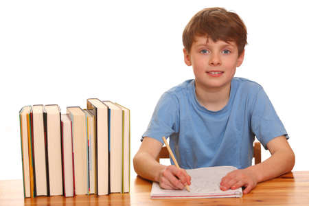 Portrait of a young boy doing his homework isolated on white background Stock Photo - 9031850