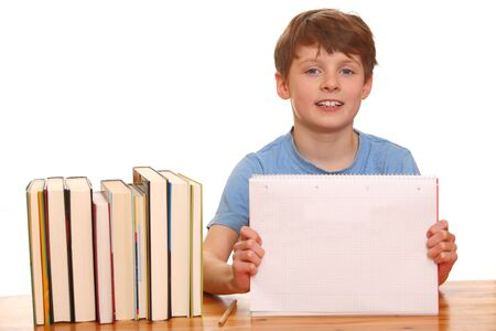 Portrait of a young boy doing his homework isolated on white background Stock Photo - 9031608