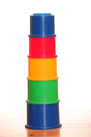 colorful child pyramid isolated on white background  photo