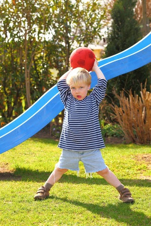 Young boy playing ball in the garden Stock Photo - 9229127