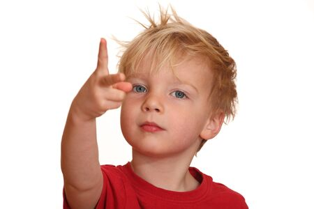 A cute little boy points with his fingers upward photo