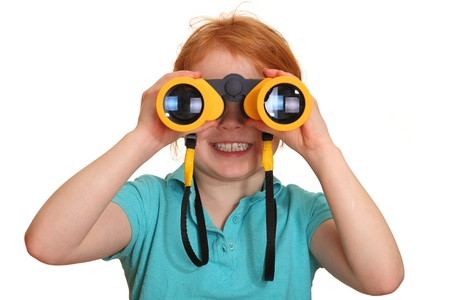 Portrait of a red haired girl with binoculars  Stock Photo
