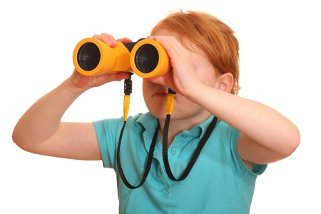 Portrait of a red haired girl with binoculars  photo