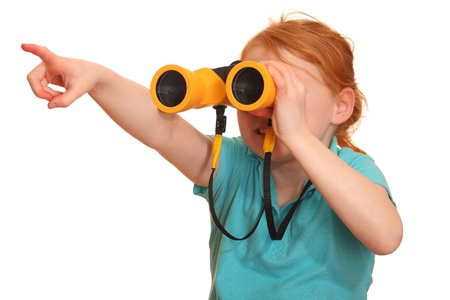 Portrait of a red haired girl with binoculars pointing upward photo