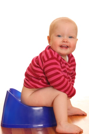 poo: Portrait of a baby girl - Potty training Stock Photo