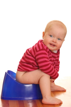 piddle: Portrait of a baby girl - Potty training Stock Photo