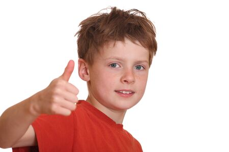 Portrait of a successful young boy with thumbs up photo