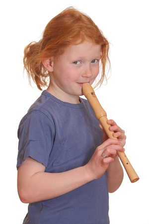 Portrait of a red-haired girl playing flute photo