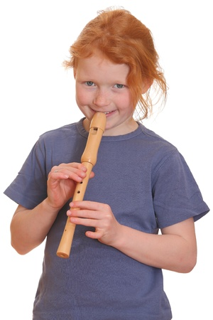 Portrait of a red-haired girl playing flute Stock Photo