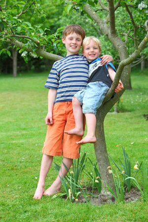 Two kids having fun in the garden photo