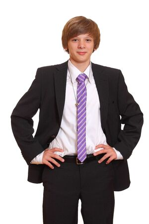 Portrait of a teenage boy in a business suit photo