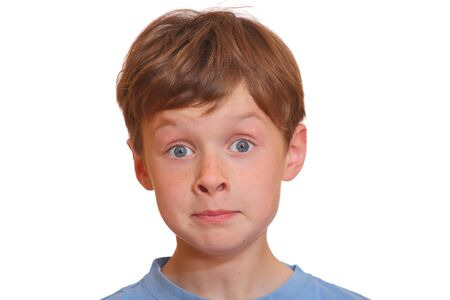 Portrait of a young boy making a funny face with eyes wide open Stock Photo - 9648409
