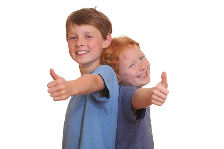 two thumbs up: Two happy young kids with thumbs up Stock Photo