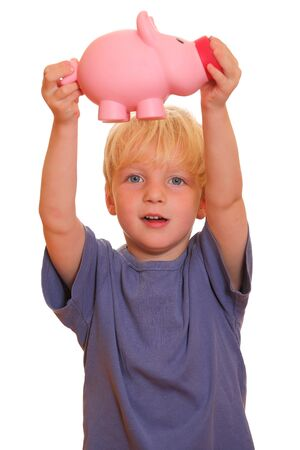 Portrait of a young boy holding his piggy bank on white background photo