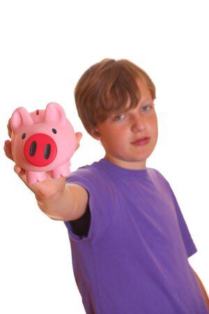 Portrait of a teenage boy showing his piggy bank photo