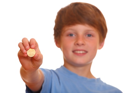 Portrait of a young blond teenage boy showing a 50 euro cent coin photo