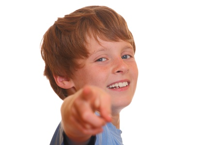Portrait of a young blond boy pointing with his finger at you photo