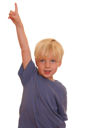 man pointing up: Portrait of a young boy pointing with his finger up