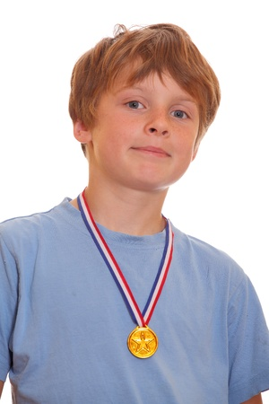 Portrait of a young boy with a gold medall on white background photo