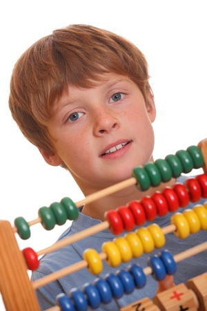 Back to school - teenage boy counting on abacus Stock Photo