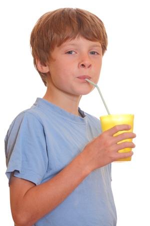 Portrait of a teenage boy drinking milk using drinking straw photo