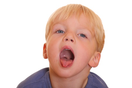 mouth  open: Naughty young boy sticks out his tongue  Stock Photo