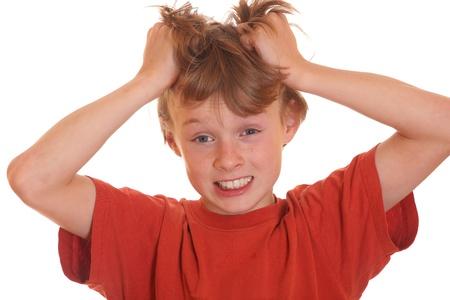 Angry teenage boy pulling his hair Stock Photo