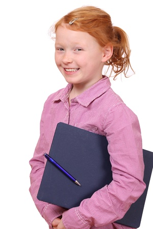 Portrait of a young red haired schoolgirl on white background photo