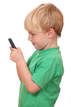 cellular telephone: Portrait of a young boy playing with his new cell phone