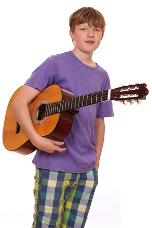Portrait of a teenage boy holding a classical guitar photo