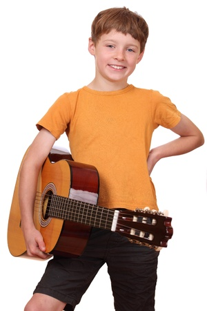 play boy: Portrait of a young boy holding a classical guitar
