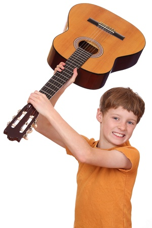 Portrait of an angry young boy with a guitar Stock Photo - 10980227
