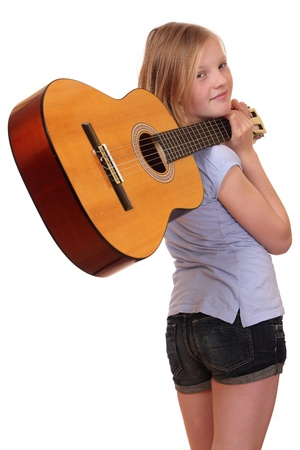 Portrait of a teenage girl holding a classical guitar photo