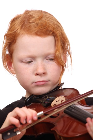 Portrait of a red haired girl playing violin photo