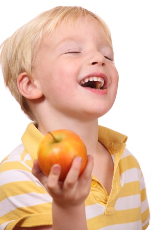 Portrait of a young boy eating an apple Stock Photo