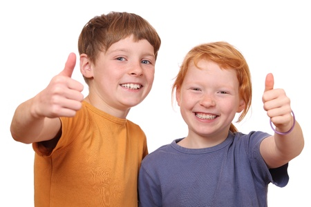 Portrait of two happy kids with thumbs up photo