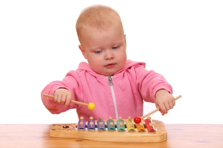 Portrait of a young girl playing a toy xylophone