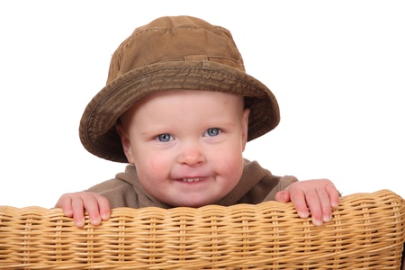 nappy new year: Portrait of a funny looking toddler wearing a green hat Stock Photo