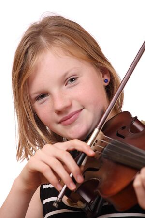 Portrait of a young girl playing violin on white background photo