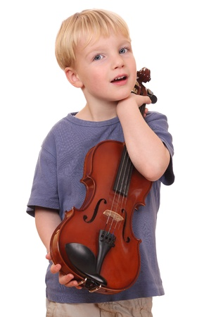 fiddles: Portrait of a young boy holding his violin Stock Photo
