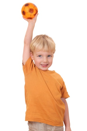 Portrait of a happy young boy holding a ball