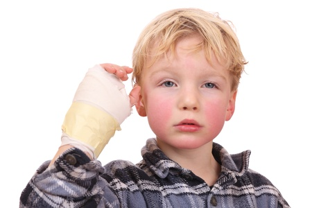 Portrait of a sad child with his hand hurt photo
