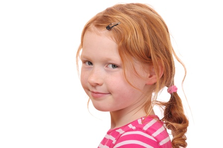 Portrait of a red haired girl on white background Foto de archivo
