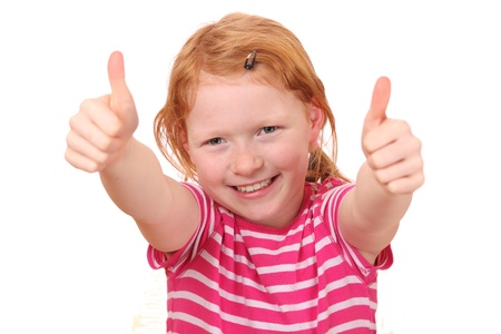 Portrait of a red haired girl with thumbs up Stock Photo - 11520016