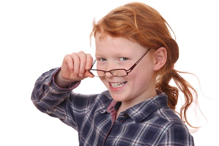 Portrait of a young girl wearing glasses on white background Stock Photo - 12030155