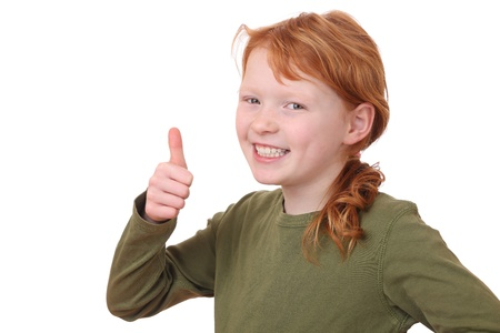 Portrait of a young girl with thumbs up on white background Stock Photo - 12030153