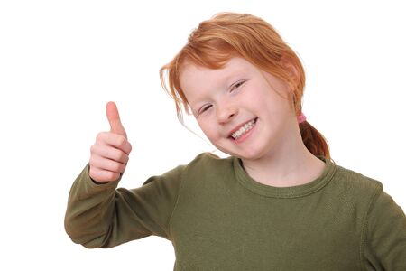 Portrait of a young girl with thumbs up on white background Stock Photo - 12030158