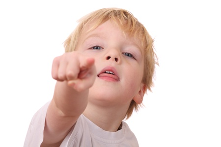 Portrait of a young boy pointing with his finger photo
