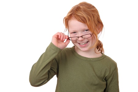 Portrait of a young girl wearing glasses on white background  Stock Photo - 12030159