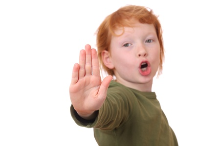 veto: Portrait of a young girl making stop gesture on white background
